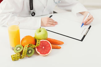 nutritionist-desk-with-fruit-and-measuri