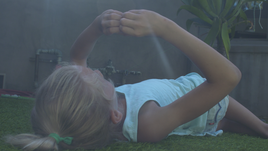Tate in her backyard