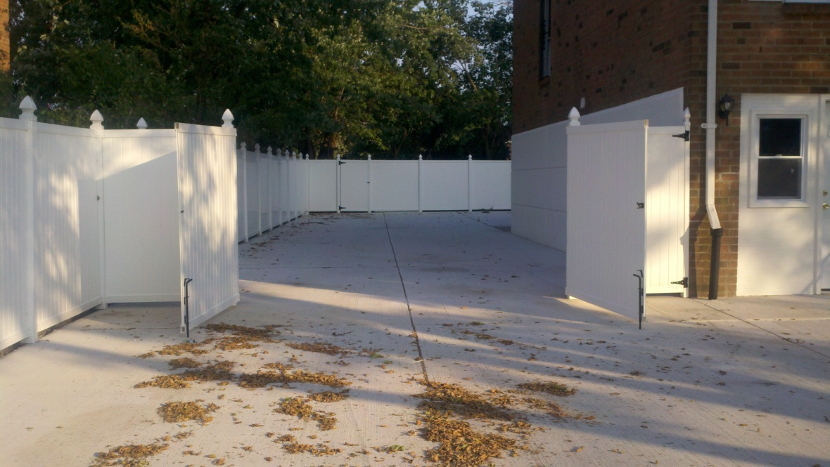 Concrete Yard with New Fence