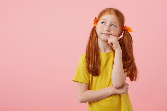 portrait-little-pensive-freckles-red-haired-girl-with-two-tails-looks-away-touches-cheeks-