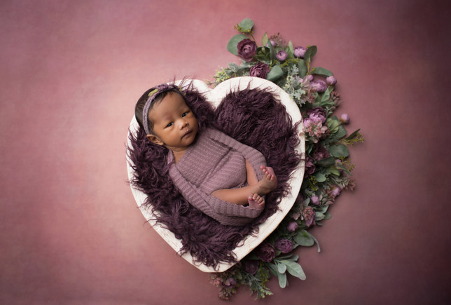 baby in a heart