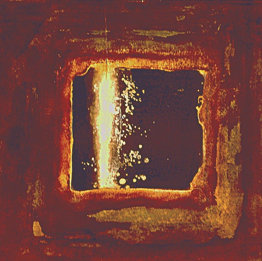 A dark, four-sided element with uneven edges emerges out of surrounding dark environment which has a distressed appearance. The central dark entity seems to be cracked, with bright pale light spilling through the fissure and dripping onto its surface. It emerges from the darkness surrounded by a glimmering aura of light.