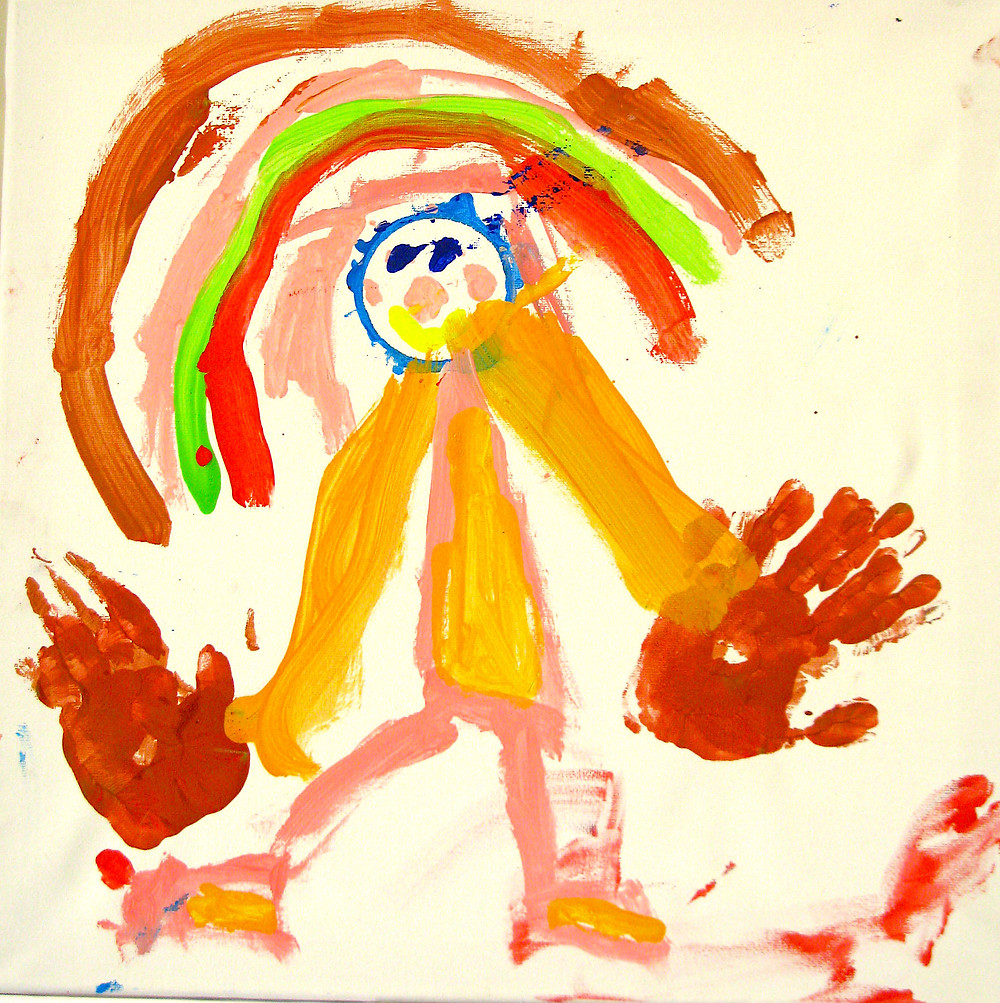 A child's painting showing a female figure wearing a yellow dres and yellow shoes. Her head has a rainbow halo around it and her relatively enormous hands are depicted in red. They are, in fact her own hand prints. They represent generous giving. Painted in a workshop for CIWOT for an exhibition of children's art in 2014 with the express purpose of raising funds for the charity, Cans For Kids.