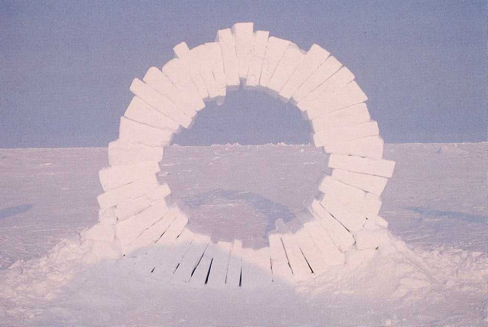Land artist Andy Goldsworthy created a massive ring sculpture by wedging a series of blocks of compressed snow to form a ring rising from the snow bed. White, pink, lilac.