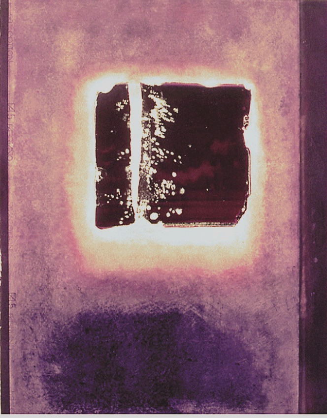 A four-sided entity with broken and chipped edges floats in a luminescent aura of pale light, surrounded by pale purple that darkens to almost black purple at the bottom  The very dark colour is echoed in a narrow band on the right of the painting.