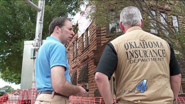 Pawnee Mayor Brad Sewell tours earthquake damages with Insurance Commissioner John Doak.