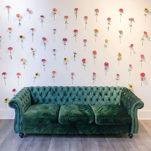 Zinnias on wall by Martha Whitney.JPG
