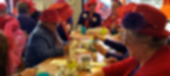 Red hat ladies at their pottery painting event