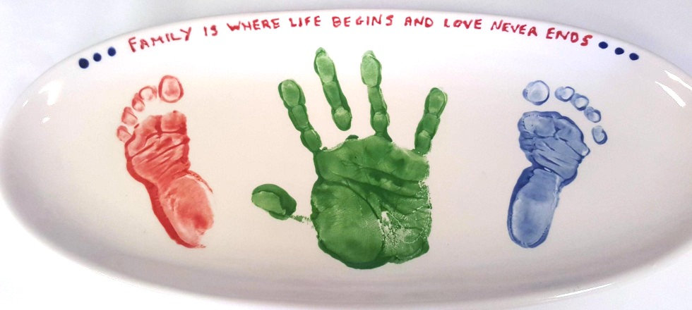 Painted on baby hand and foot prints
