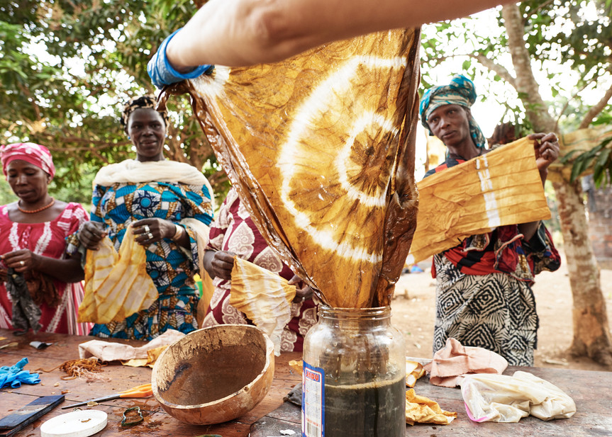 Adire folding resist workshop with kola nuts and iron water
