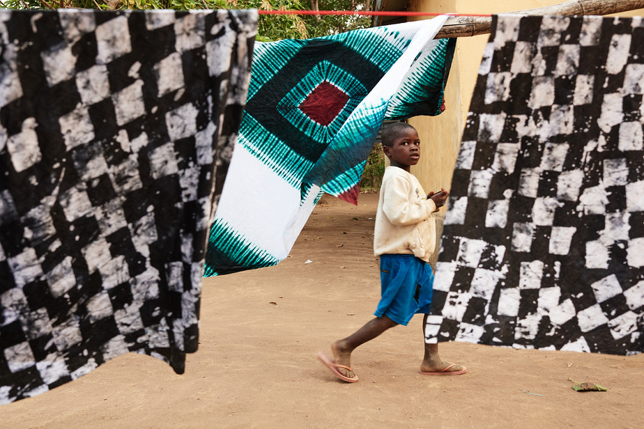 Boy and indigo batiks, Modiya 2019