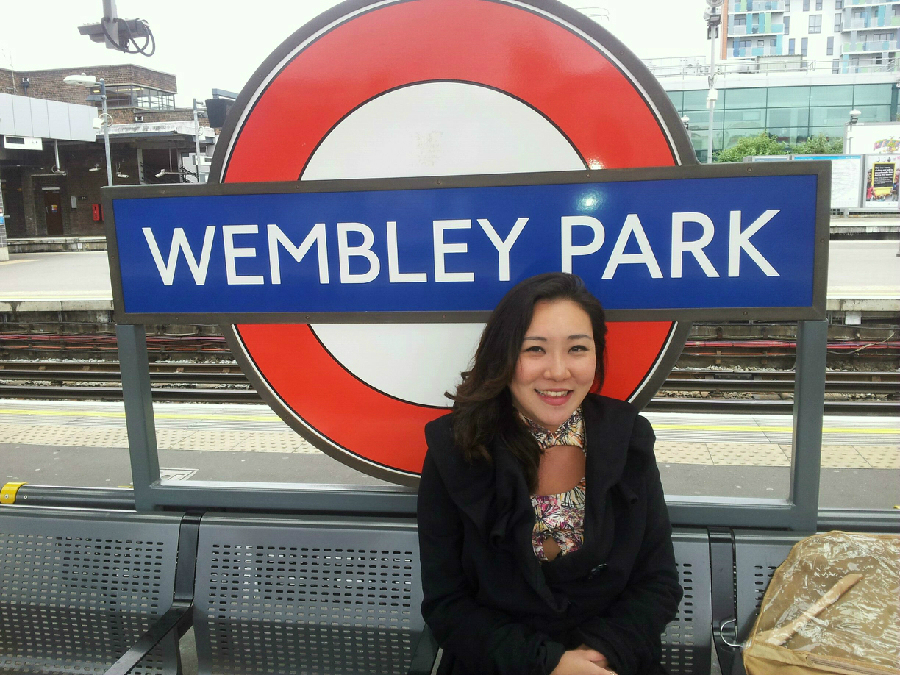 Rose Jang in front of Wembley Tube