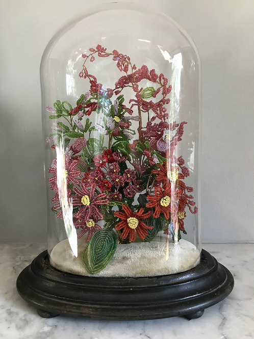 An Pretty Victorian Glass dome with beadwork flowers