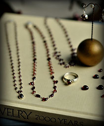 Our handcrafted jewelry collection features beautiful garnet necklaces, rings, and earrings