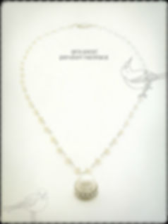 The Aria pearl pendant necklace, made with stunning natural white pearls