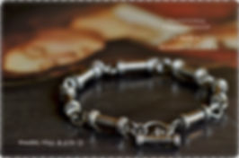 Handcrafted artisan bracelets, rings, and silver baby spoons