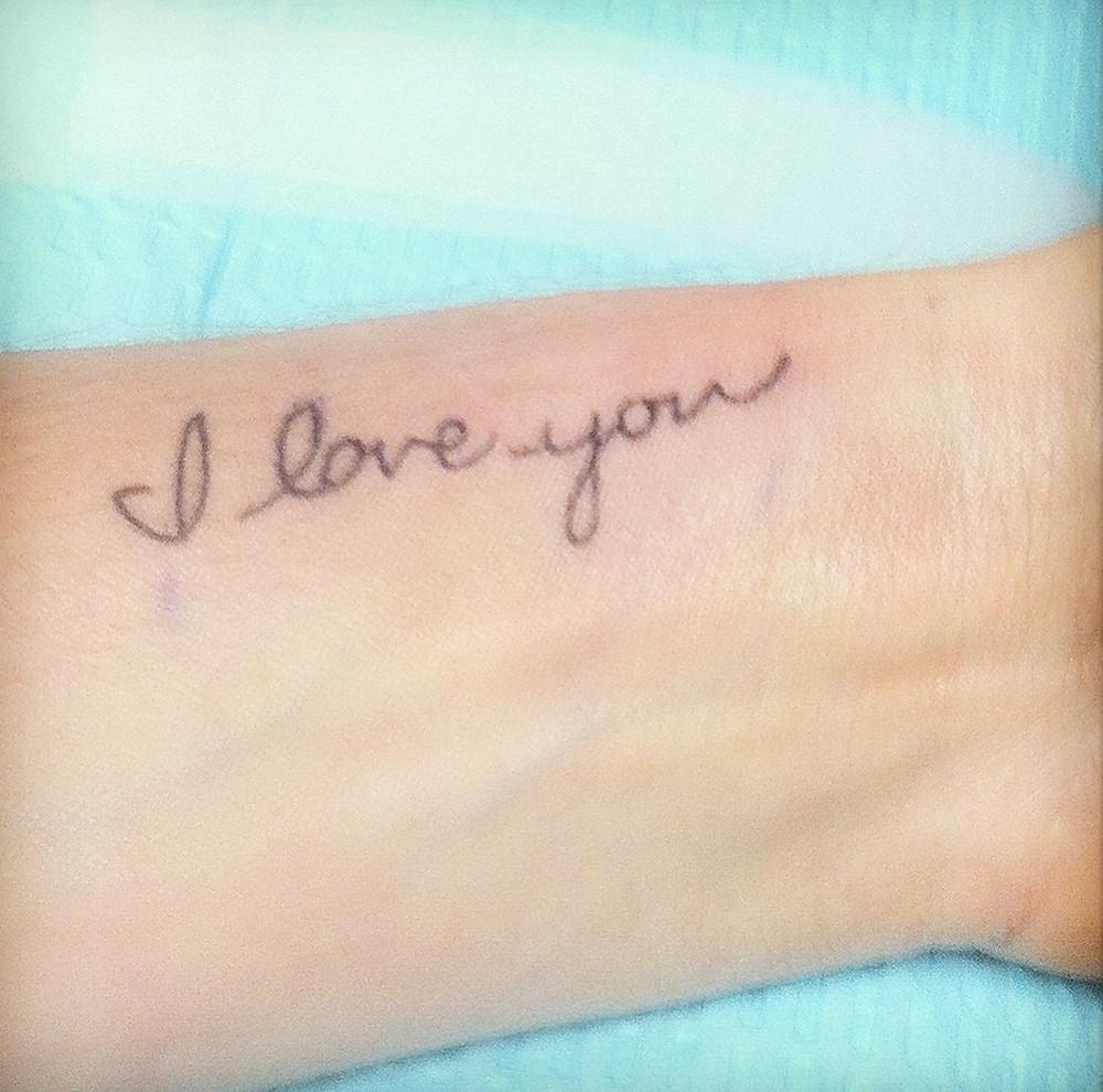 """I love you tatoo"" on Andrea Catherine's wrist"