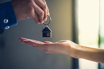 Seller Handing Off Home Keys.jpg