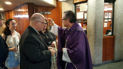 Having some items blessed by the Bishop at Our Lady of Guadalupe