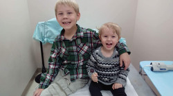 Big brother Jacob helps Elizabeth thru a doctor's appointment!
