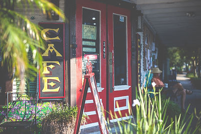 New Orleans real estate in Algiers Point, Algiers Point cafe, cafe sign, red doors