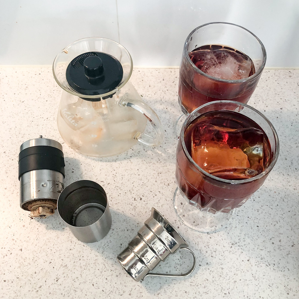 Coffee Mezcal Negroni with large blocks of clear ice.