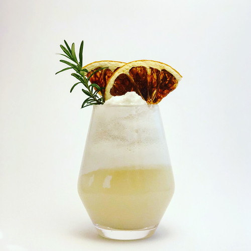 Cocktail with Seared Grapefruit and Roasmary Garnish