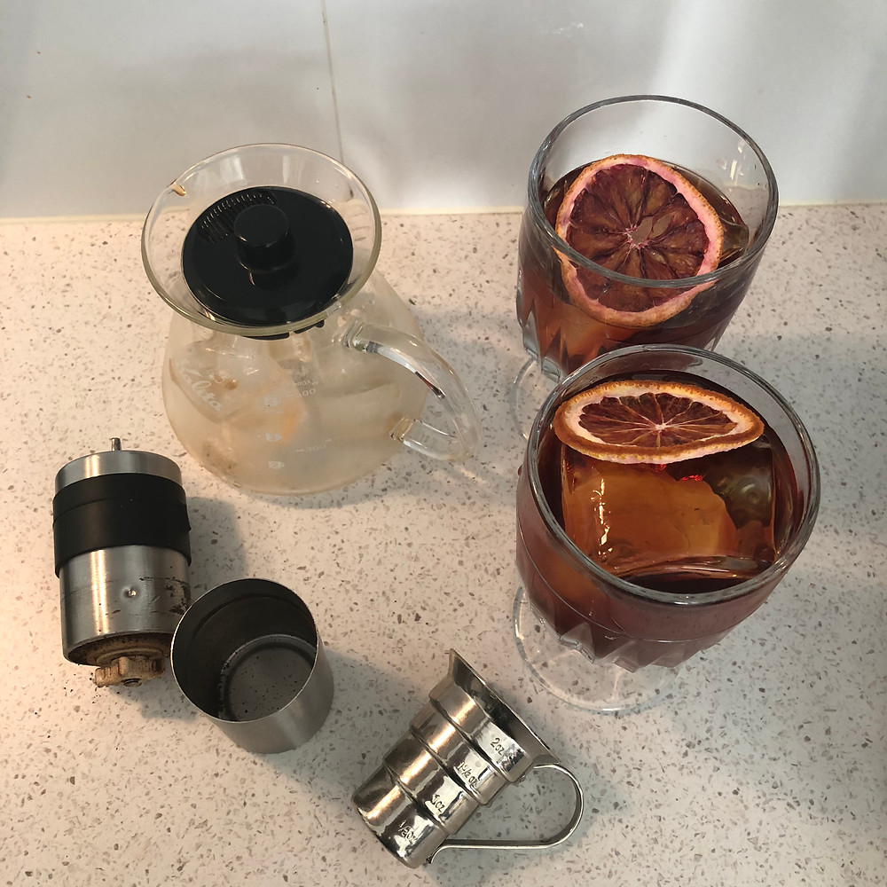 Coffee Mezcal Negroni garnishes with There Will Be Blood Orange