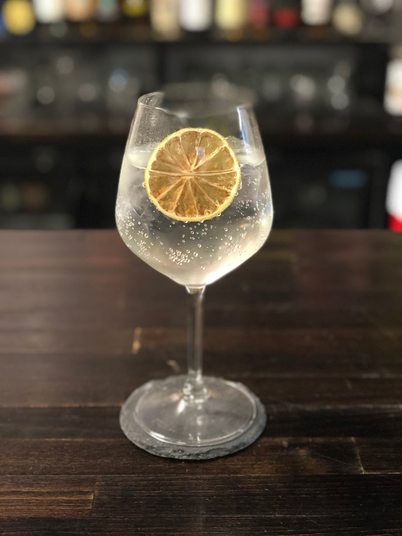 Gin and Tonic with Roasted Lemon Garnish