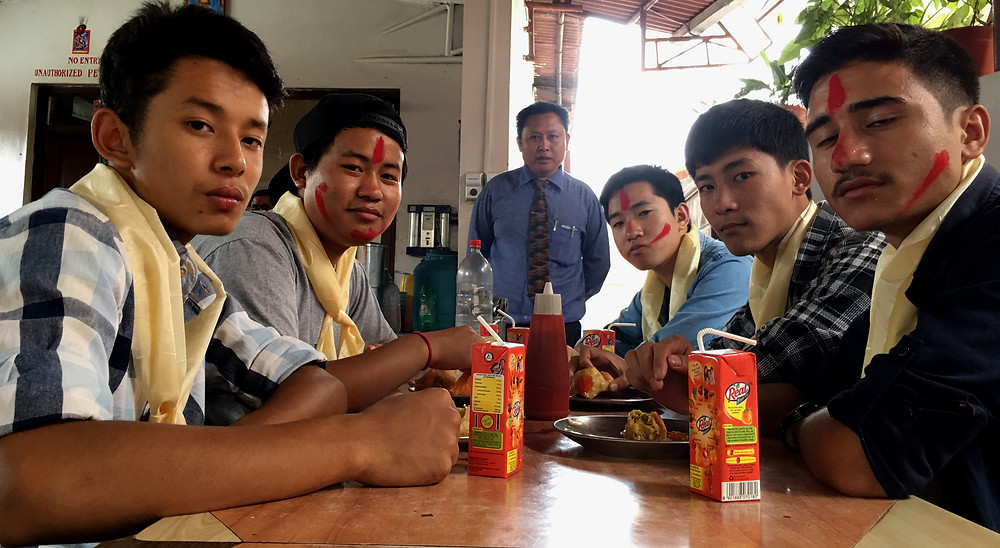 Boys enjoying Hi-Tea during farewell programme.