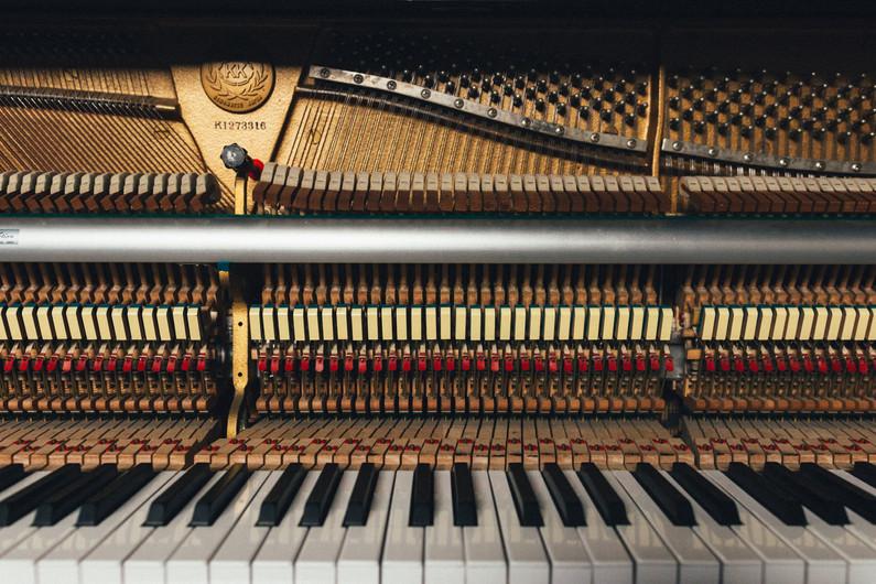 Piano hammers on strings.jpg