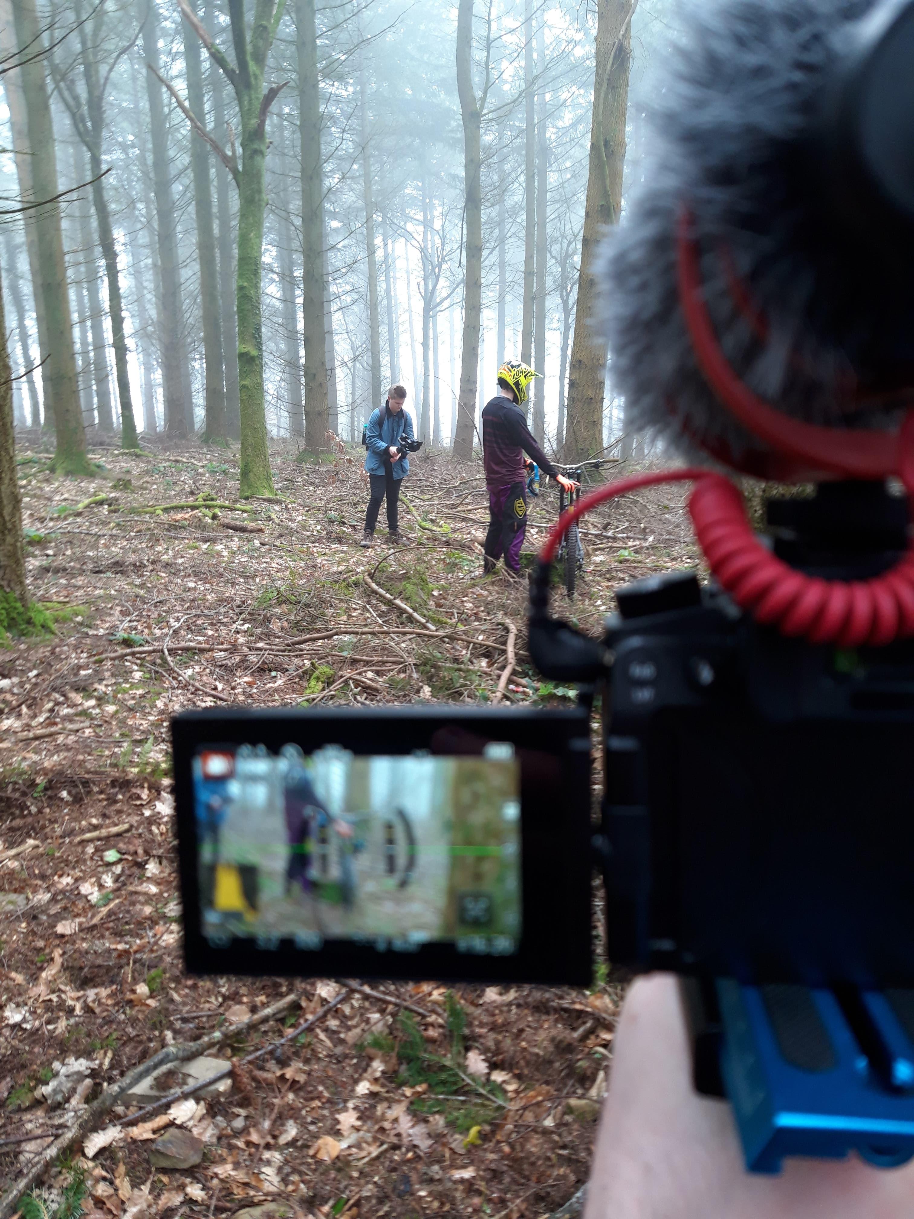 Filming mountain biker