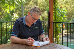 termite technician writting out a termite report