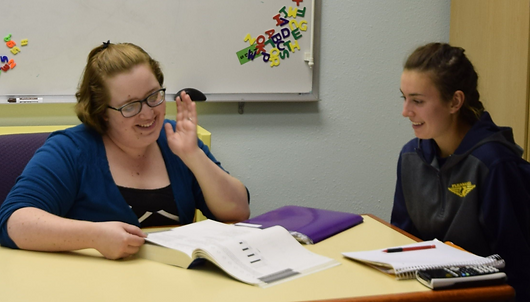 A tutor working on test preparation with a student.