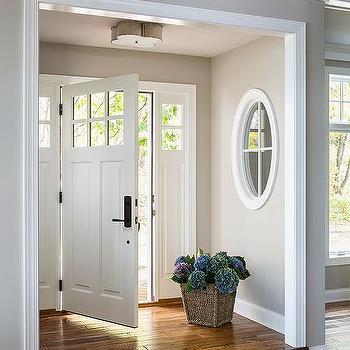 m_step-up-to-front-door-basil-flush-mount-foyer-nook-design-ideas