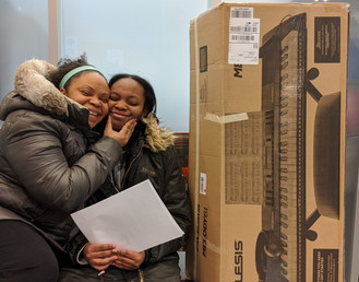 People's Music School student Honour and mom receiving keyboard donation