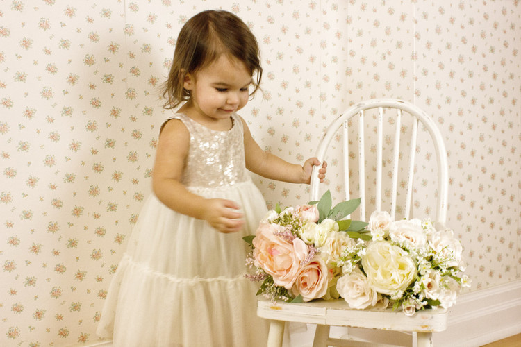 Flower girl picking out which bouquet she desires.