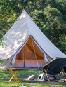 Glamping camping teepee tent and chairs