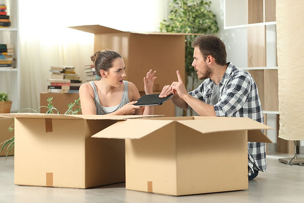 A couple stressing and arguing about long distance moving, something that can be eliminated by calling Melendez Moving at (773) 677-9041.