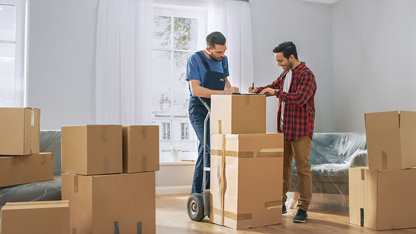 happy new homeowner receives his goods and signs on clipboard
