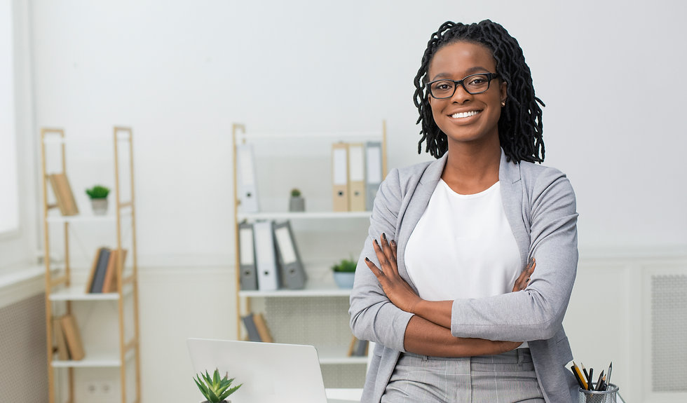 smiling-black-businesswoman-sitting-on-d