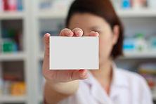 pharmacist showing white blank medicine