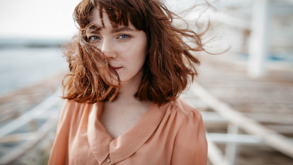 stock photo of young woman with wind in hair