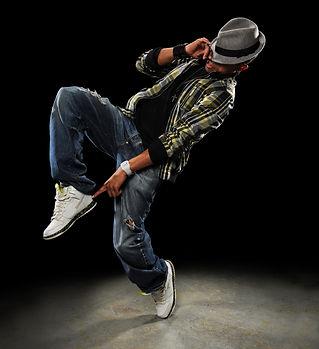 African American dancer performing over dark background.jpg
