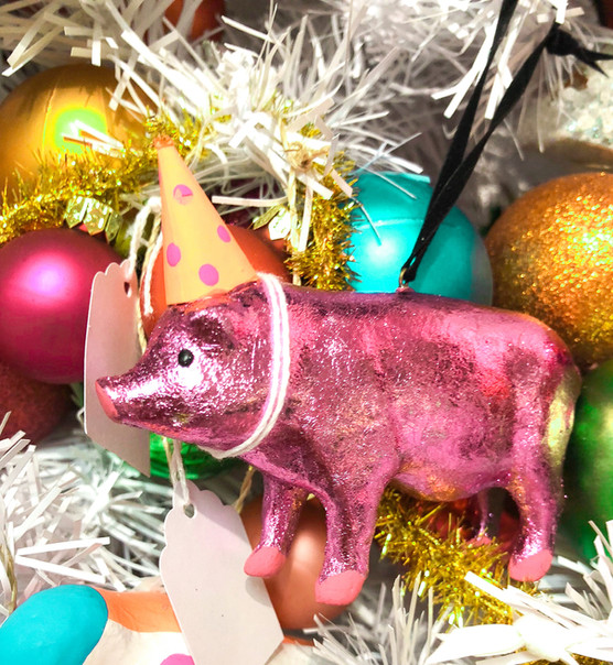 Pink, sparkly pig with party hat ornaments by Cody Foster