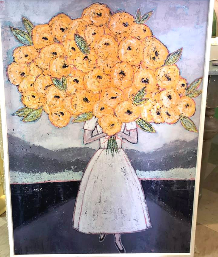 Painted girl holding yellow flowers
