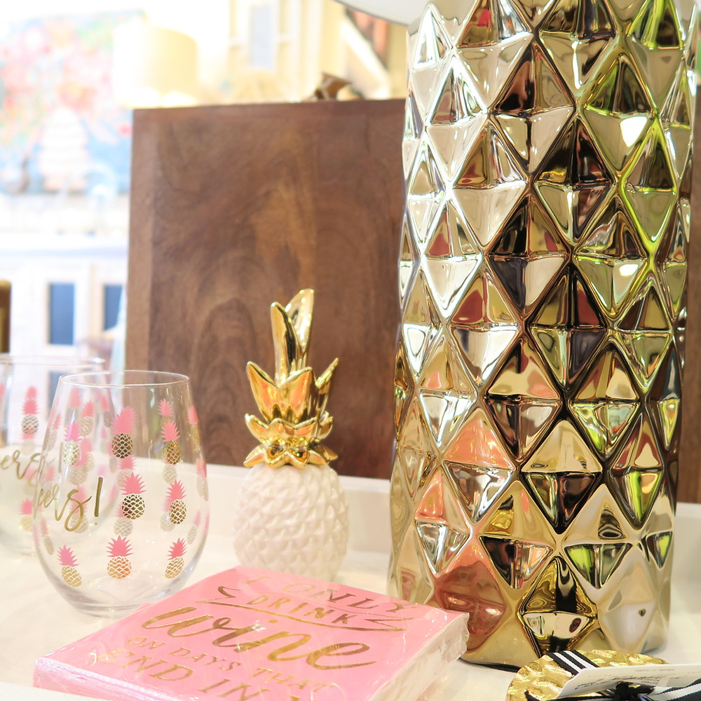 Gold pineapple vases, trinkets, party glasses and festive napkins