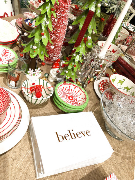 Believe books, trinkets, holiday bowls, candles, and metal christmas trees, oh my!