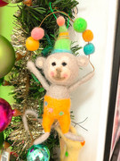 Baby gift ornaments shaped like juggling circusmonkeys