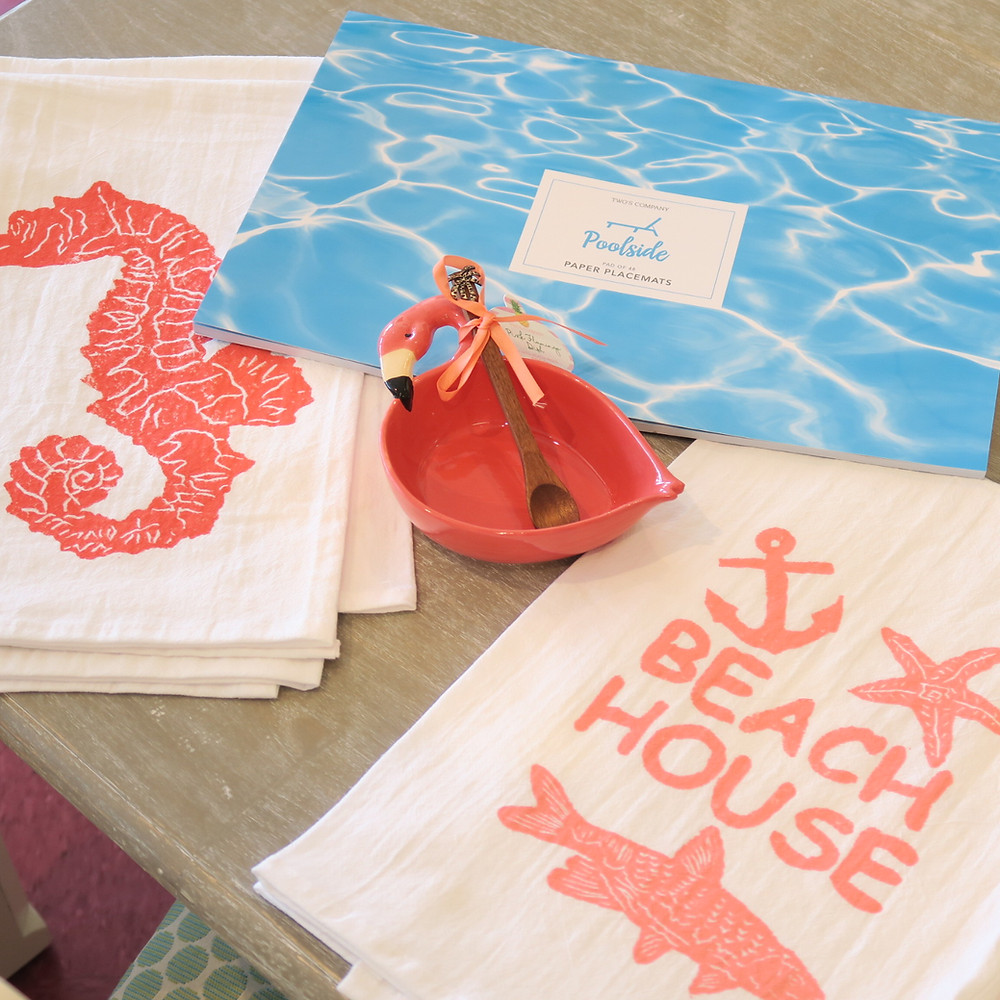 Flamingos, poolside placemats, and beach towels